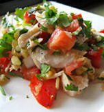 Fish salad with tomatoes and apples