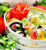 Eggplant rolls with bryndza, garlic and tomatoes