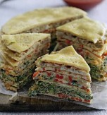 Layered omelet cake with vegetable stuffing