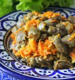 Stewed chicken hearts with vegetables