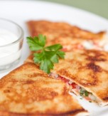 Pancakes with Brynza (Feta Cheese) and Tomatoes