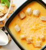 Potato, cheese, and carrot soup with chicken broth