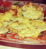 Baked chicken and potatoes with cheese