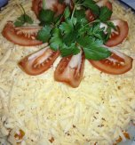 Layered salad with chicken, potato and champignons