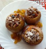 Baked apples stuffed with walnuts, raisins, and dried apricots