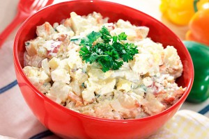 Beef and potato salad with green peas