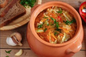 Sour cabbage soup with pork