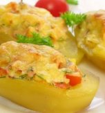 Baked potato with chicken, tomato, and cheese