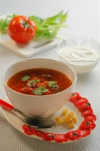 Cold tomato soup with tomato and red onion