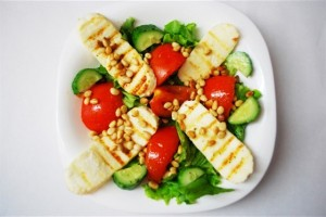 Warm cheese salad with vegetables