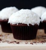 Chocolate cakes with coconut flakes