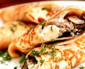 Pancakes stuffed with mushrooms