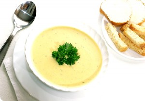 Potato soup with cream, smoked trout, and horseradish