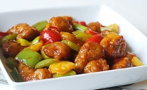 Fried pork with bell peppers and tomatoes