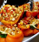 Vegetarian Stuffed Bell Peppers under Tomato Sauce