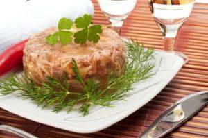 Chicken, pork, and beef kholodets