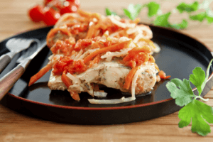 Fish baked with carrot and tomato