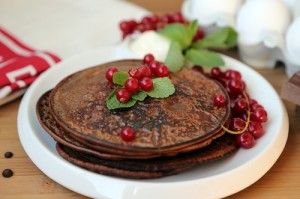 Chocolate pancakes with red currants