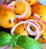 Browned potatoes and red onion