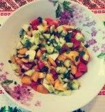 Red and yellow tomato, cucumber, and onion salad
