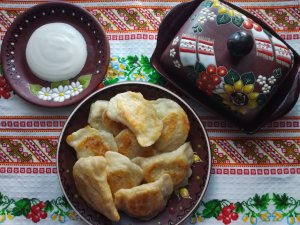 Dumplings with potato, cheese, and tomato filling