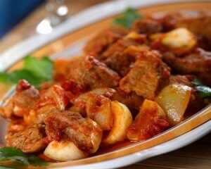 Beef stew with root vegetables and champignons