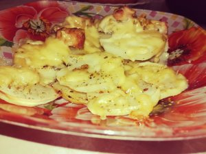 Roasted chicken and potatoes with cheese