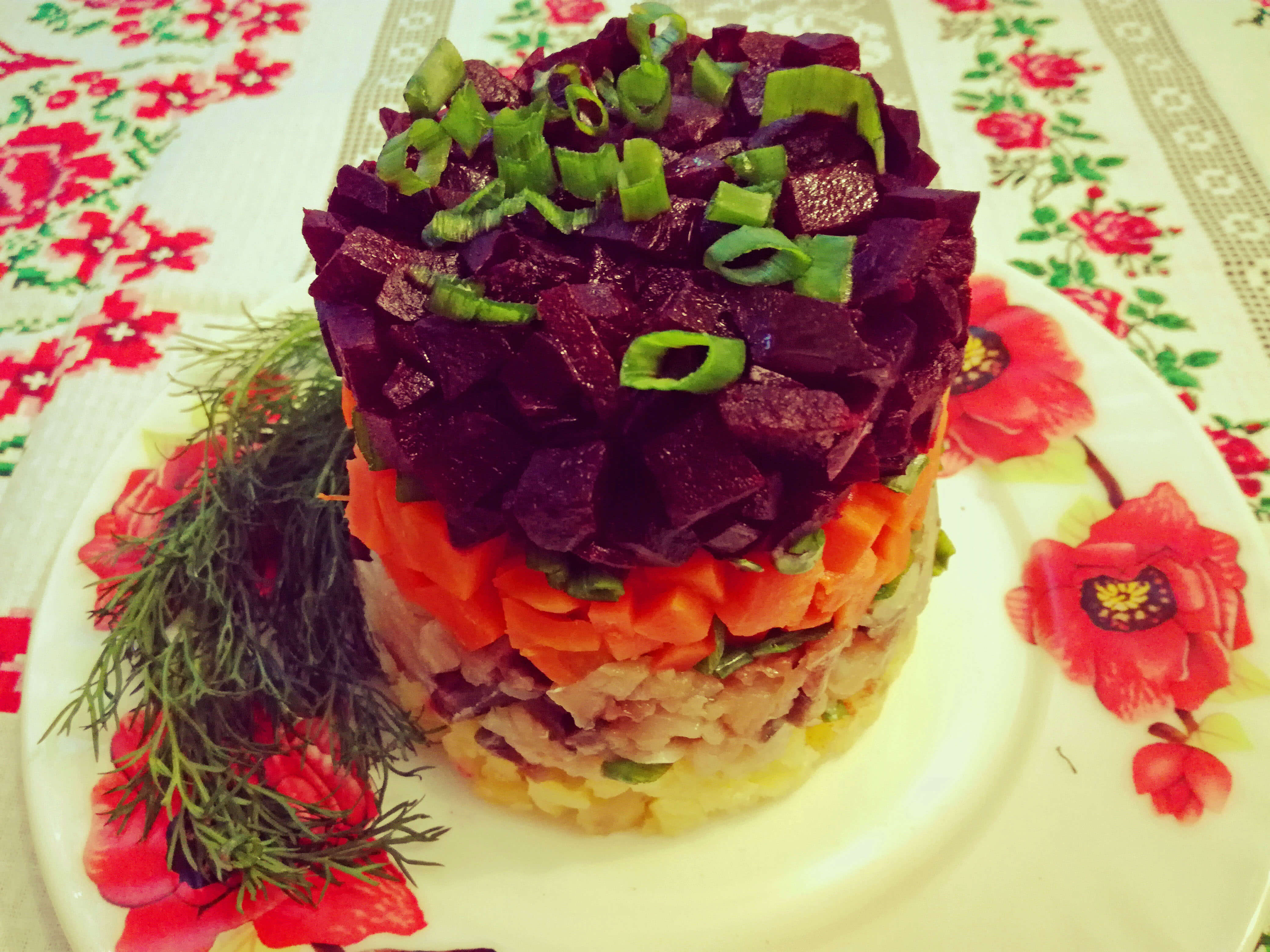 LAYERED PICKLED HERRING SALAD WITH TART APPLES AND RED ONION