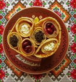 Rolled pancakes with poppy seeds, sour cherries, and cottage cheese